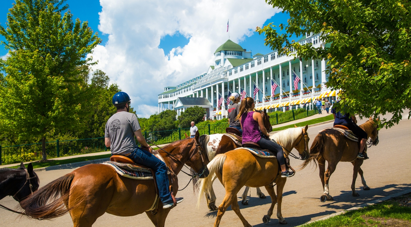 horseback riding in front of the Grand Hotel
