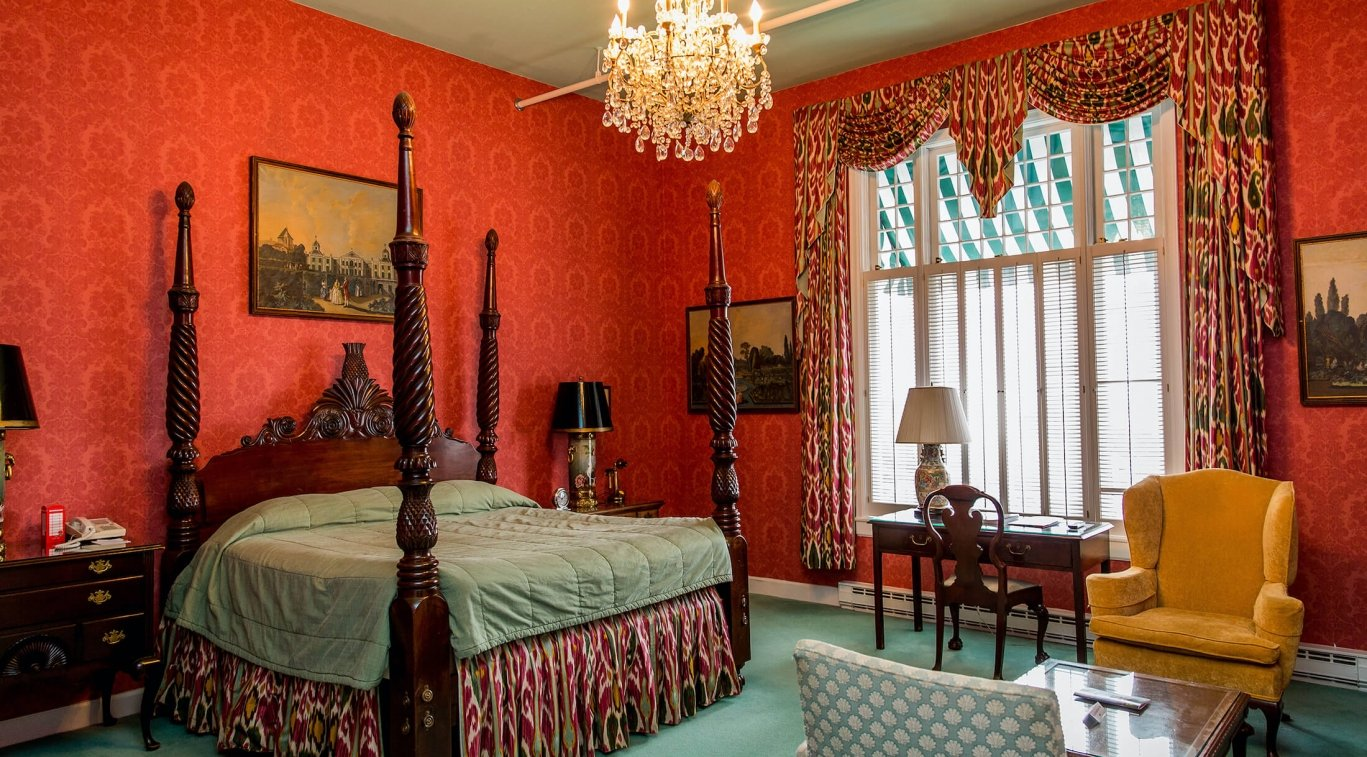Suite with king bed and chairs