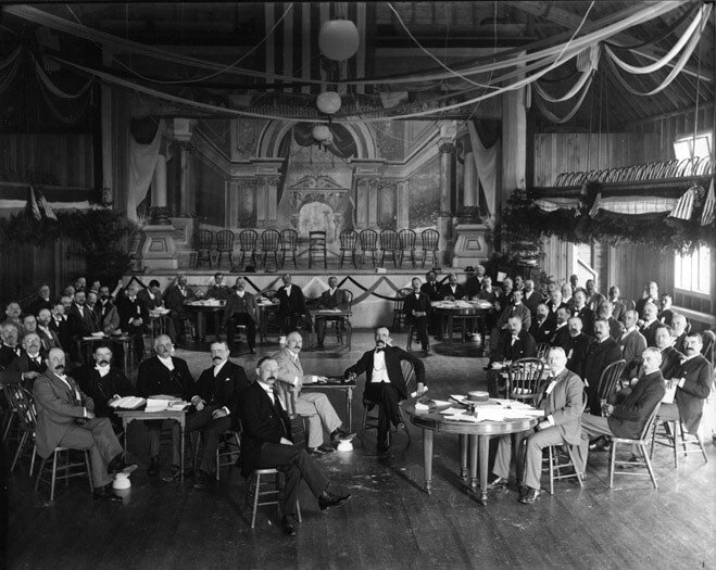 An old black and white photo of a large meeting