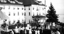 An old black and white photo of women and children playing outdoors
