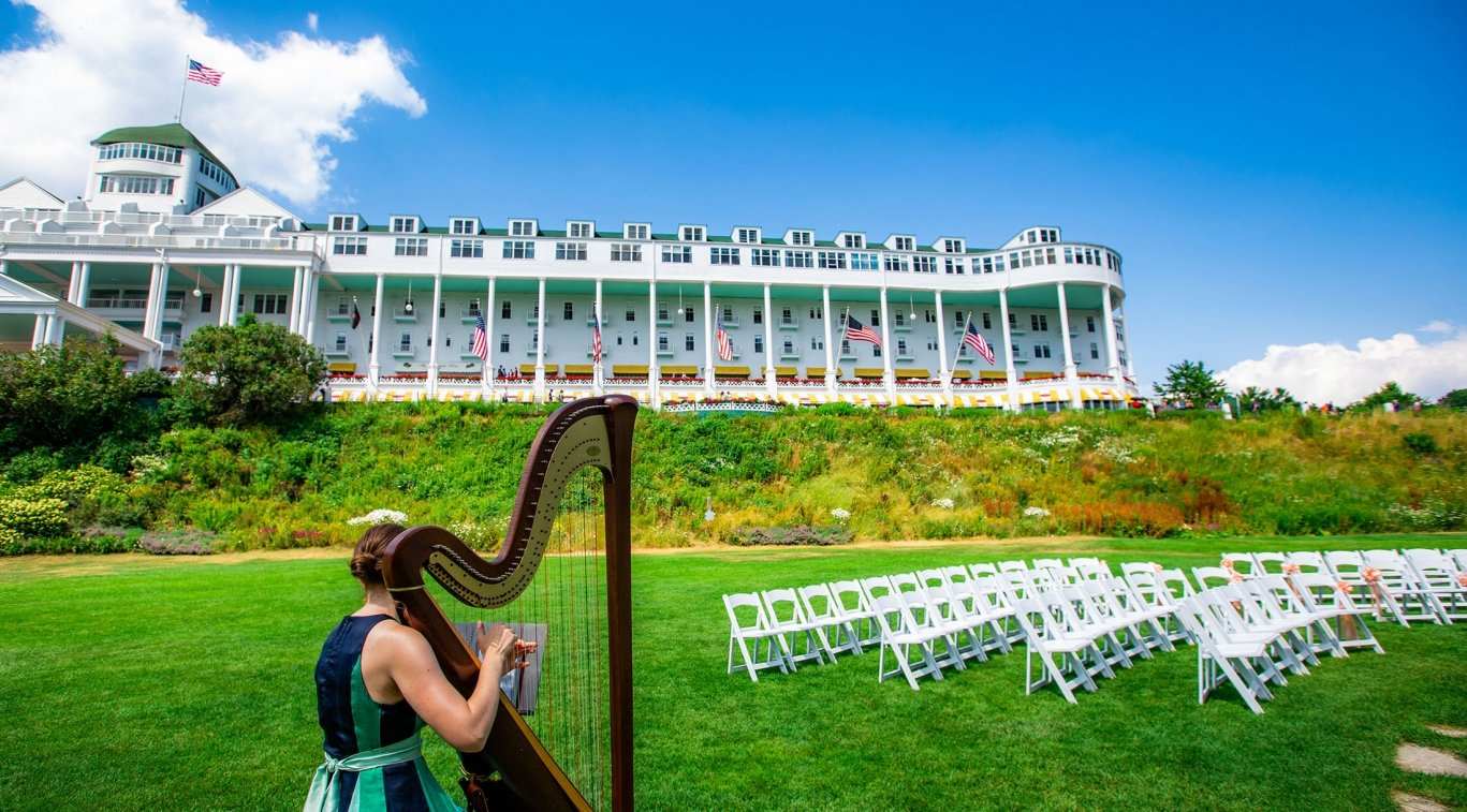 A harpist on the lawn