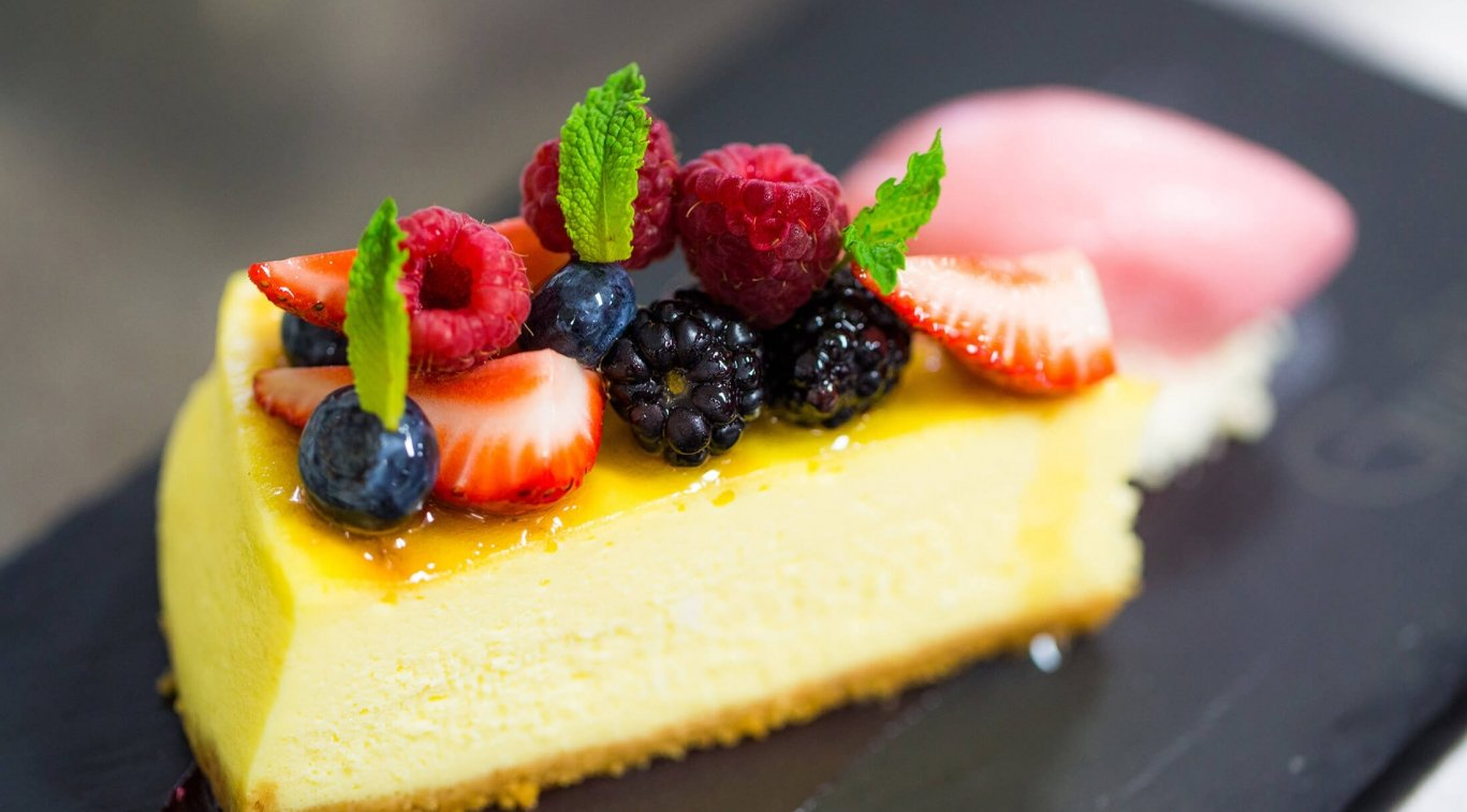 A cheesecake topped with berries