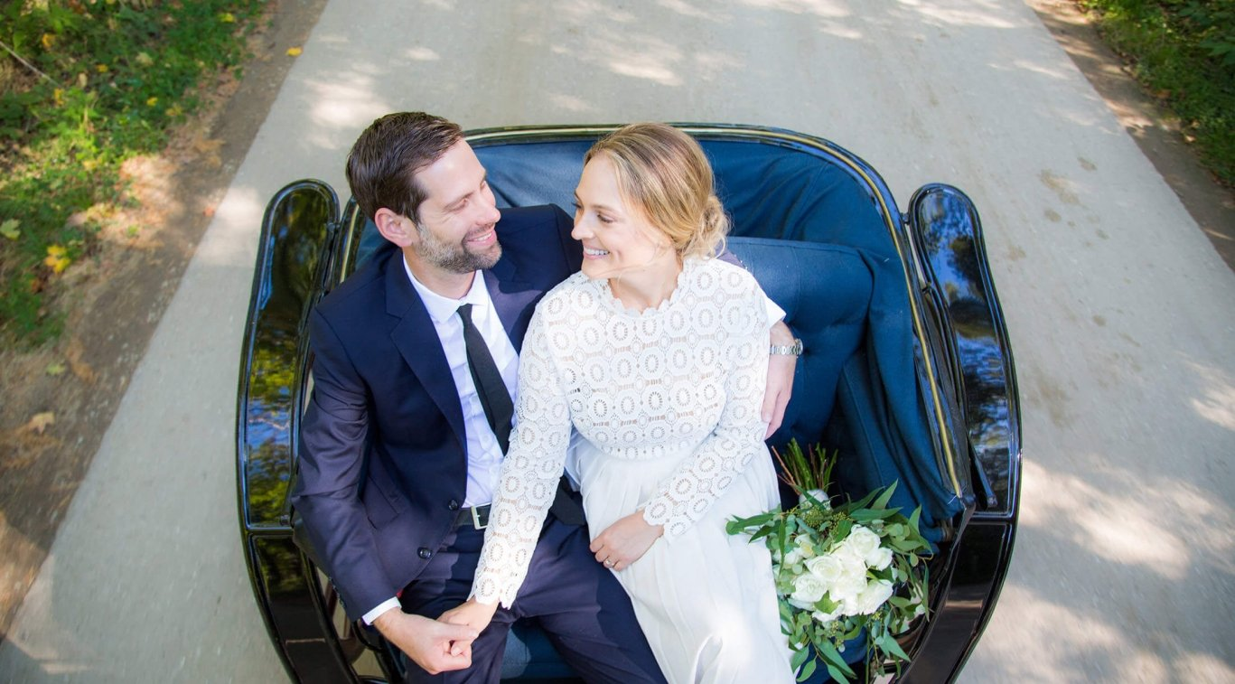 A newly-married couple in a carriage
