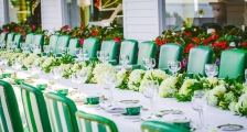 A long wedding dinner table set for many guests