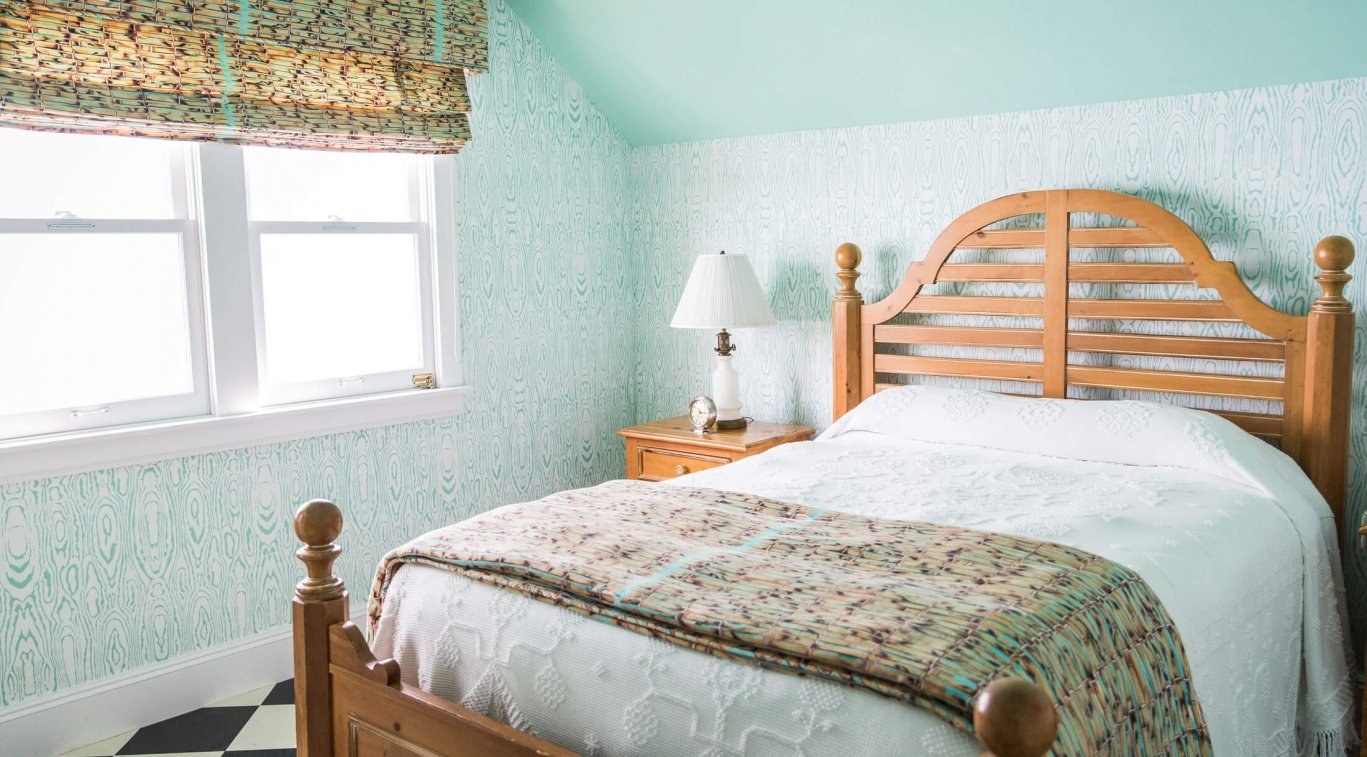 A bedroom in Masco Cottage