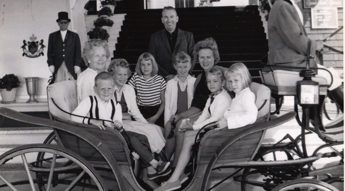 An old black and white photo of a family in a carriage