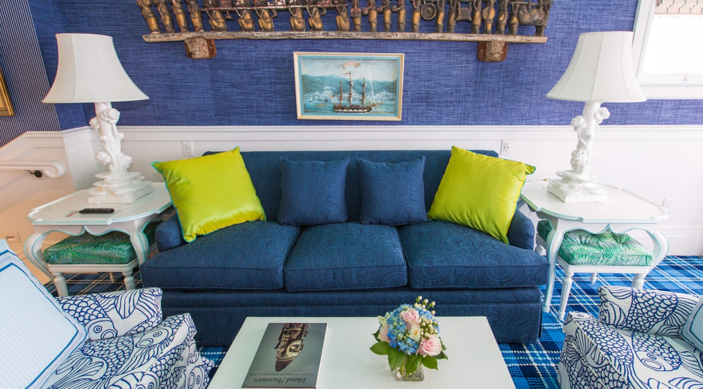 A blue sofa in the sitting room