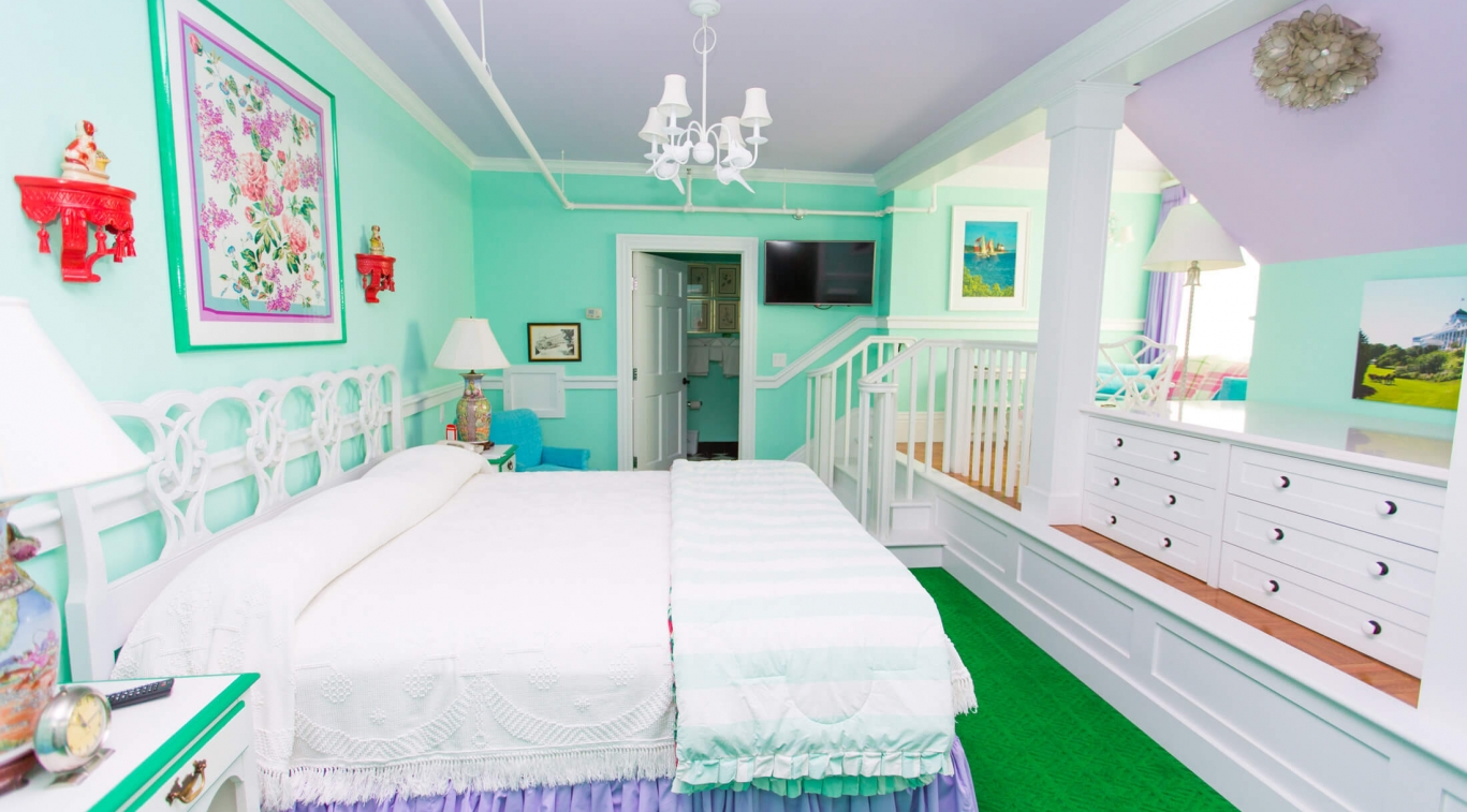 A long bedroom in Cupola Suites