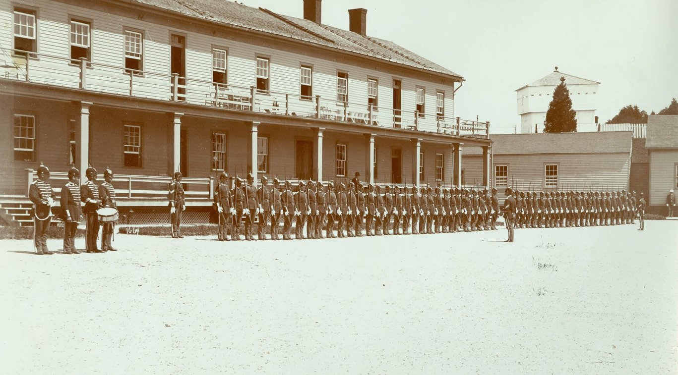 An old black and white photo, the interior of Fort Mackinac