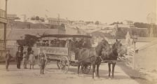 An old black and white photo of a horse-drawn carriage