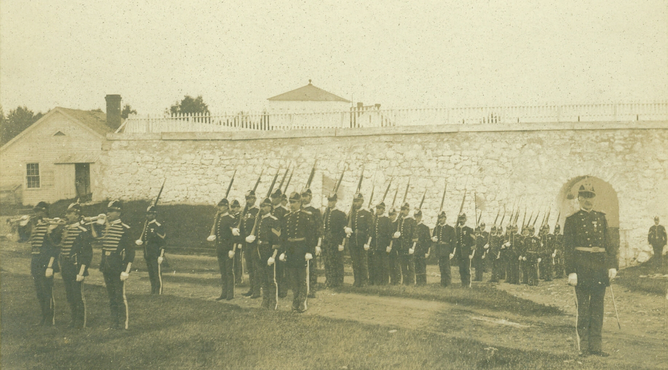 An old black and white photo of soldiers during a parade
