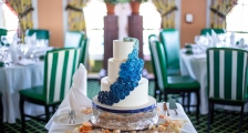 A wedding cake on a table at a reception