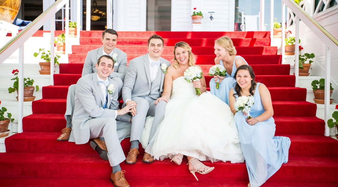 A bridal party sitting on the steps